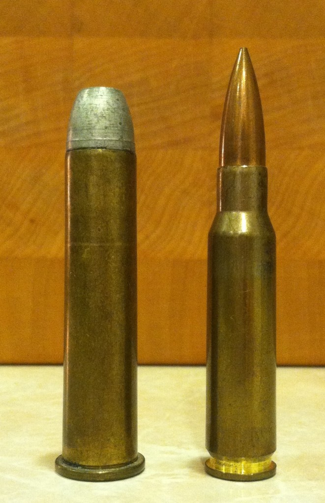 A .45-70 with a 350gr cast lead bullet compared to a 7.62x51mm (.308 Winchester) cartridge.