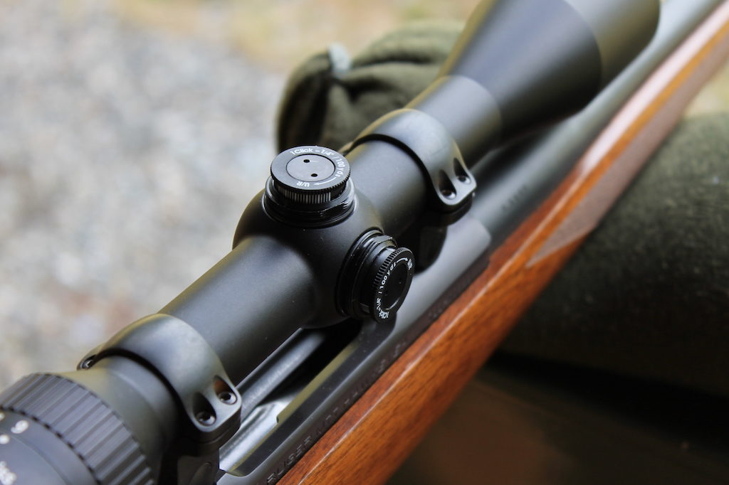 how to sight in a rifle scope adjustment